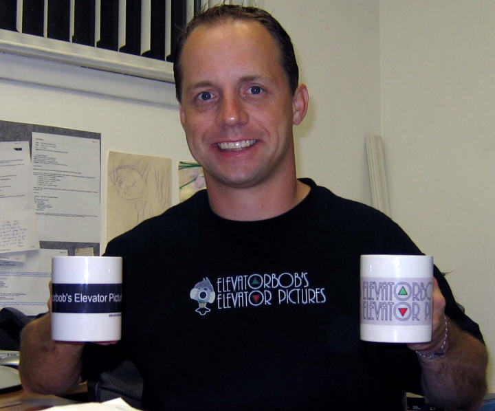 Tom Sybert and his mugs and T-shirt!